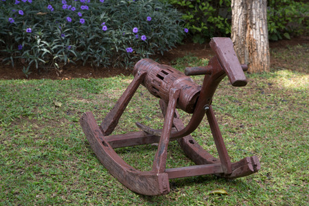 rocker: Wooden horse rocker in a green lawn
