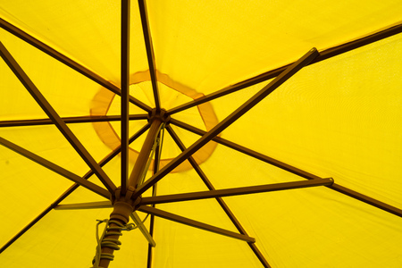 underside: Close up on the underside of a yellow umbrella