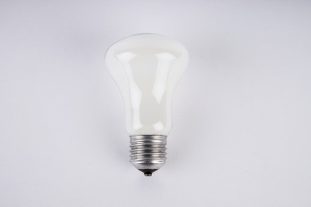 incandescent: Close up on incandescent light bulb isolated