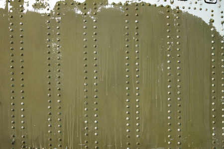 rivets: Grungy metal surface background with rivets buttons Stock Photo