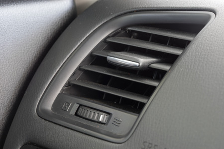 vent: Air conditioner vent grill in a modern car Stock Photo