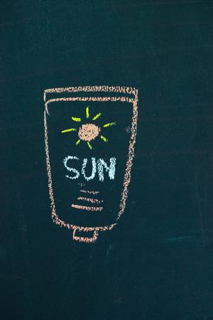 sun screen: Chalk cartoon drawn on black black board