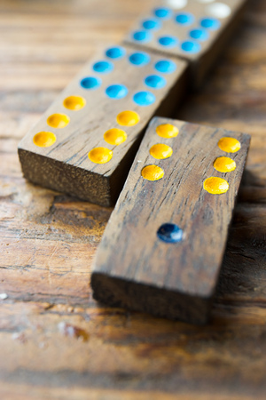 Domino play pieces lying on a wooden table