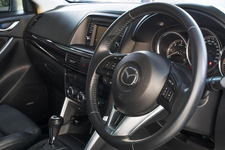 mazda: THAILAND - CIRCA 2016: Interior of Mazda CX5 model with the steering wheel visible.