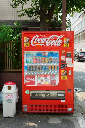capita: OSAKA, JAPAN - CIRCA AUGUST, 2016: Vending machines of various company in Tokyo. Japan has the highest number of vending machine per capita in the world at about one to twenty three people.