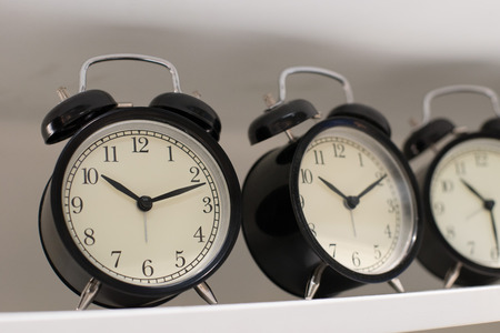 Close up on clock hanging on the wall Stock Photo