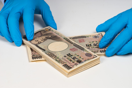forgery: money on table Stock Photo