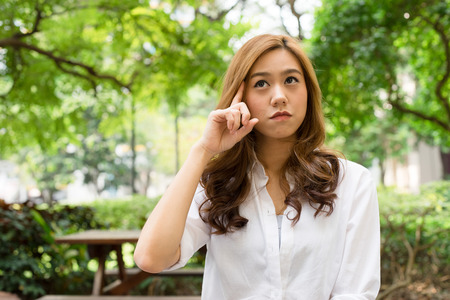 curiously: Attractive asian lady giving thinking curiously Stock Photo