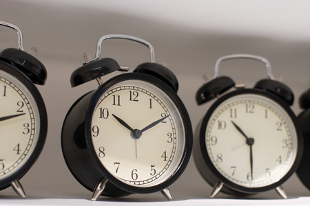 working hours: Close up on clock hanging on the wall Stock Photo