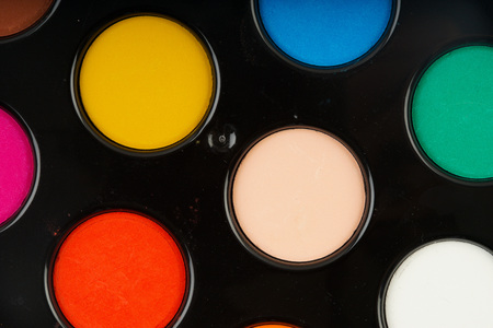 Colorful water color palette in black plastic bucket