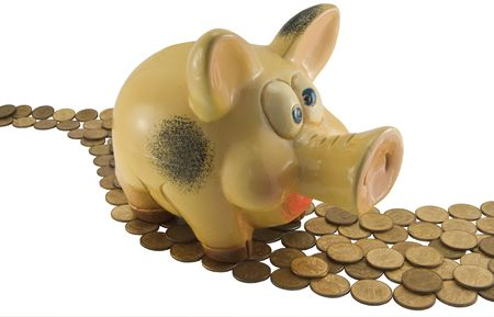 Pig a coin box on a footpath from coins photo