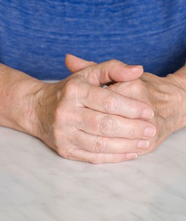 Parent hands combined against each other on a dark blue background  photo