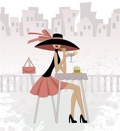 menina em um chapéu senta-se no café contra a cidade velha