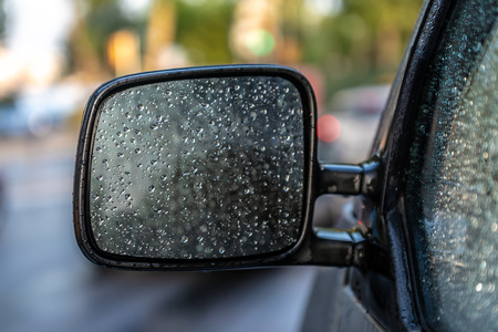 Water droplets on car mirror Stock Photo