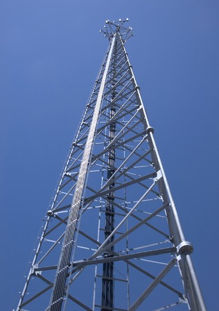A view up a cell phone tower against the exceptionally blue southwestern sky