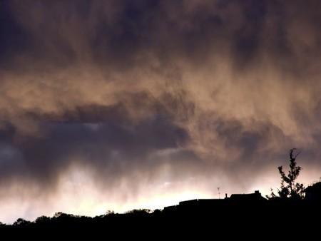 Sunset casting dramatic shading on isolated desert showers Banco de Imagens