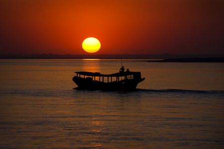 lonelyness: Irrawaddy sunset with a shadow of the boat