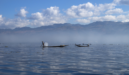 fisher: inle lake fisher with mountains