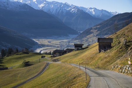 Street reaching into the frozen valley, Pass Thurn, Tirol, Austria Stock Photo