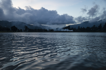 Lake of Nuwara Eliya after sunset with clouds and smoke