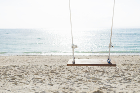 nusa: Swing at the beach with sunlighted water in front of the ocean, nusa lembogan, Bali, Indonesia