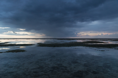 Blue Raincloud at the ocean after sunset, Gili Air, Lombok, Indonesia Stock Photo