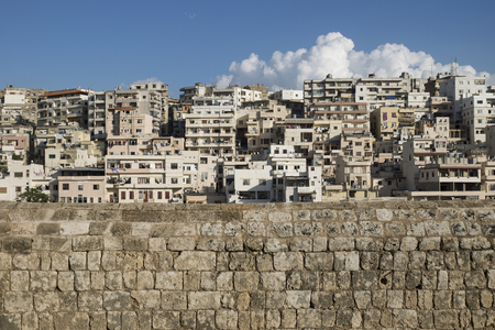 tradional: View to the slums with the walls of Citadel of Raymond de Saint-Gilles with cloud, Tripoli, Lebanon