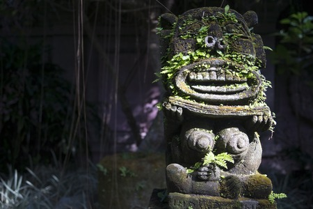 arma: Monkey spirit sculpture with moss in Arma Museum on the right, Ubud, Bali, Indonesia