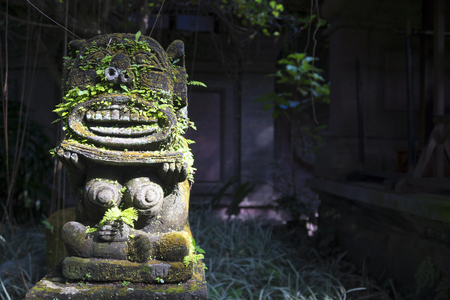 arma: Monkey spirit sculpture with moss in Arma Museum on the left, Ubud, Bali, Indonesia Stock Photo