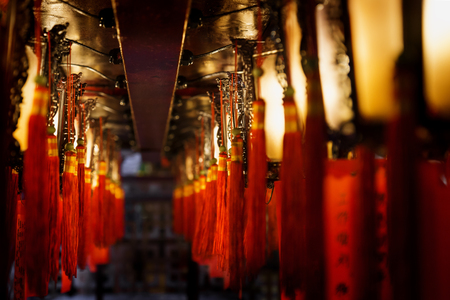 laterns: Laterns in gold and red in a row at Man Mo temple, Hong Kong, Asia Stock Photo