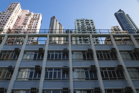 overcrowded: Low angle view on apartement buildings in different colors in Hong Kong, Asia