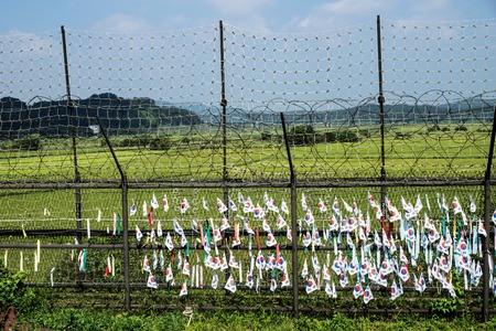 South korean flags and ribbons at a fence at the green demilitarised zone DMZ at the freedom bridge, South Korea, Asia