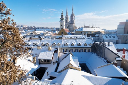 architecture monumental: View over Zagreb during winter with snow with view to towers of church and cathedral at a sunny day, Zagreb, Croatia, Europe