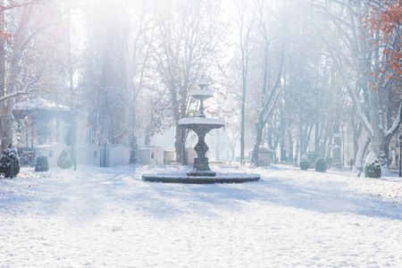 Fountain and advent stalls of Zrinjevac Park in Zagreb in cold winter with snow and sunshine, Croatia, Europe Stock Photo - 89918831