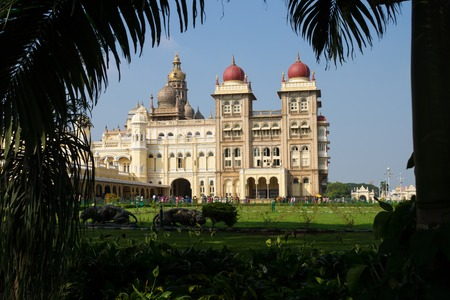 Mysore Palace and garden with palm trees with blue sky, Mysore, India