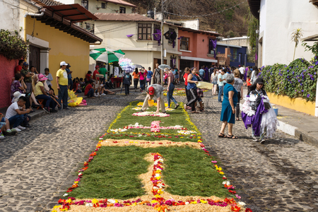 Antigua, Guatemala: March 18 2018: Local working on alfombres, flower carpets on the cobbled streets for the procession San Bartolome de Becerra
