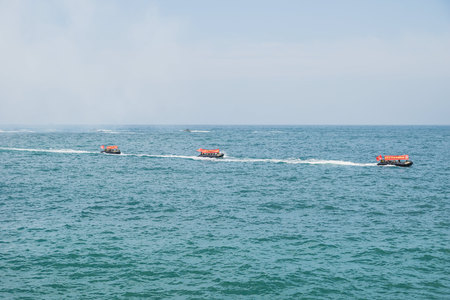 Jeju-si, Jeju Island, South Korea - August 31 2017: Three army boats with flags in a row for a military exercise Editorial