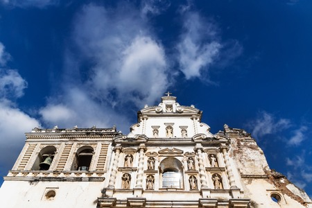 Templo de San Francisco el Grande from low angle view with blue sky and clouds in Antigua, Guateamala, Central America Stock Photo