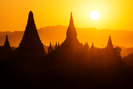 Silhouettes of Burmese Pagodas during sunset from the view of Shwesandaw Pagoda, Bagan, Myanmar