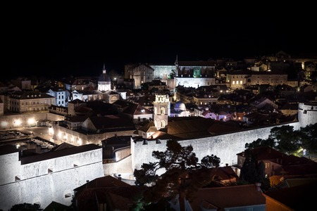 Aerial view of Dubrovnik old city at night with ligntened stone wall, Croatia Stock Photo