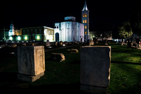 Roman Forum, Church Sv. Donat and red lightned bell tower of Zadar at night, Croatia, Europe