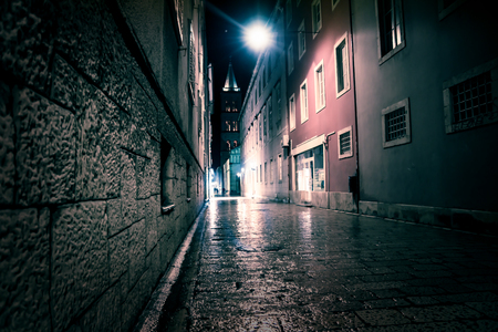 Blue ligntened cobbled street with bell tower at the end of the street, Zadar, Croatia, Europe