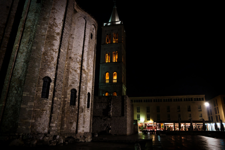 Red lightned bell tower at the main square of Zadar at night, Croatia, Europe
