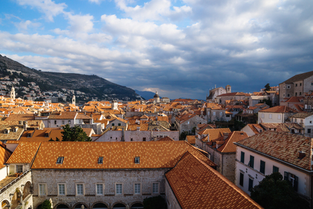 View over the old city Dubrovnik with mountains and sunny dramatic cloudscape, Croatia