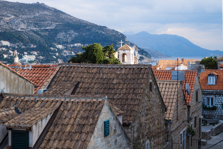 View over the old city Dubrovnik with ancient roofs and mountains and dramatic cloudscape, Croatia Stock Photo
