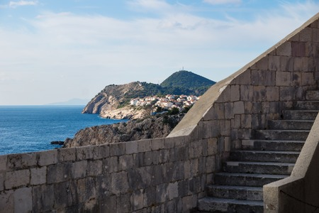 View from the fort walls and stairs in Dubrovnik on the dark blue ocean, Croatia