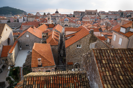View over the ancient roofs of old town Dubrovnik with church towers and ocean in winter, Croatia