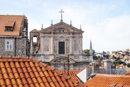 View over the roofs of Dubrovnik and church St. Stepan with bell tower, Croatia