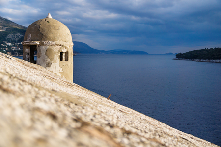 Watchtower along the fortress of Dubrovnik along the blue ocean, Croatia Stock Photo