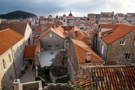 View over the roofs of old town Dubrovnik and ruin with church towers and ocean in winter, Croatia